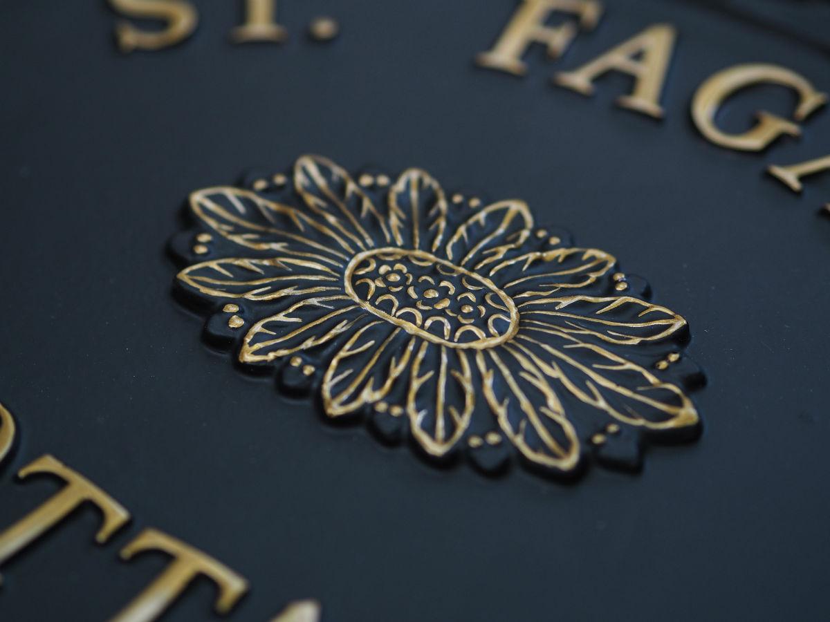 Gold Emblem Close Up house sign