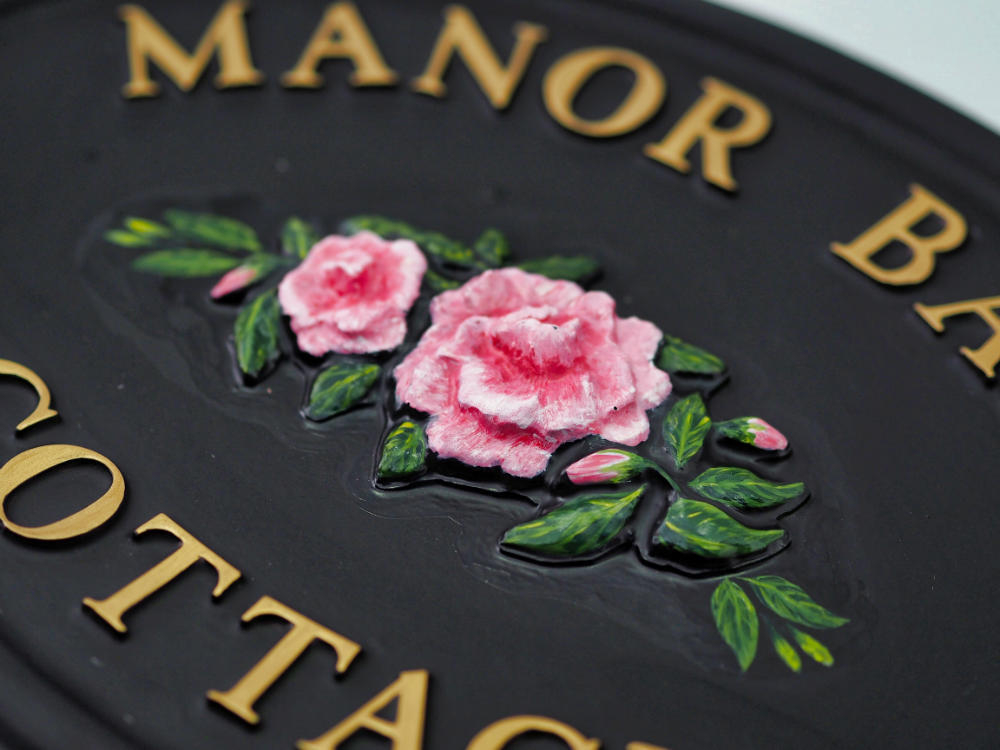 Camellia close-up. house sign