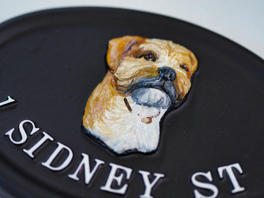 Border Terrier close-up. house sign