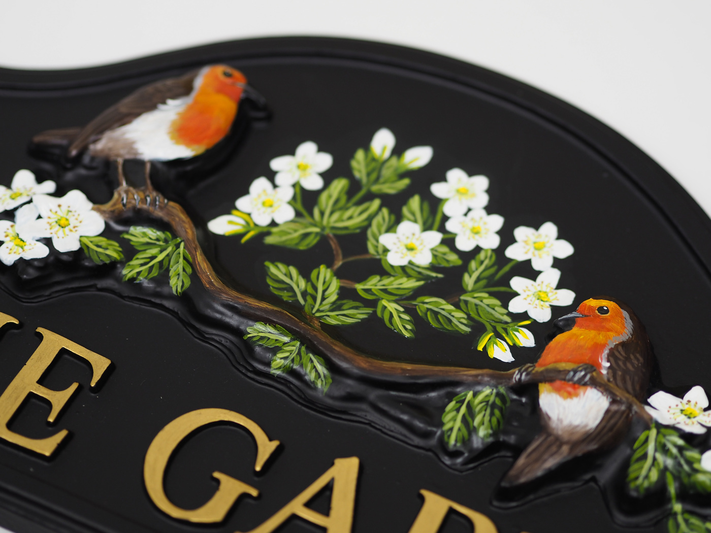 Robins On Branch close-up. house sign