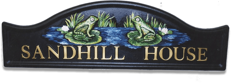 Frogs house sign