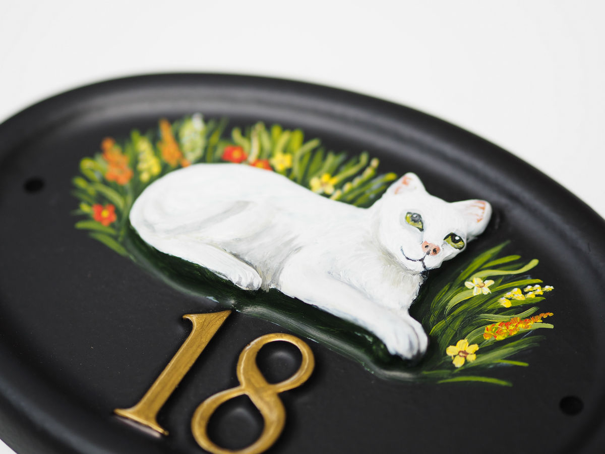 Cat Laying Close Up house sign