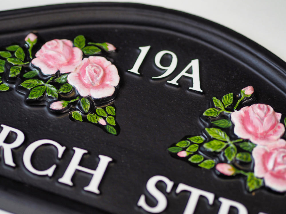 Roses Split close-up. house sign