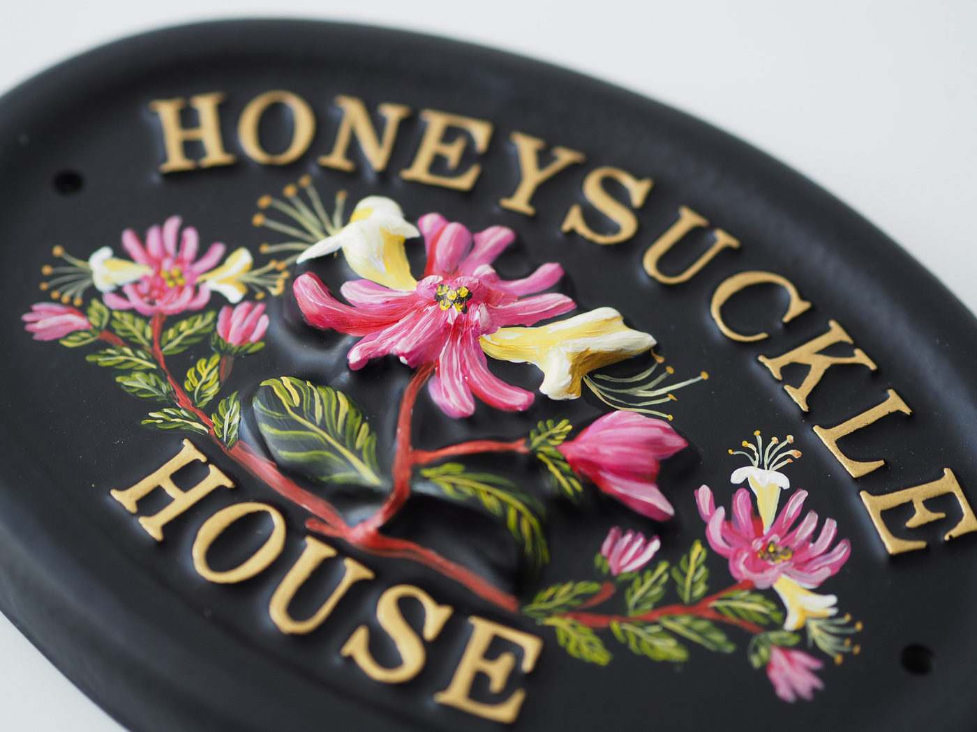 Honeysuckle close-up. house sign