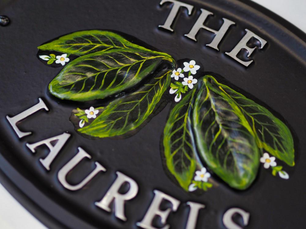Laurel Leaves close-up. house sign