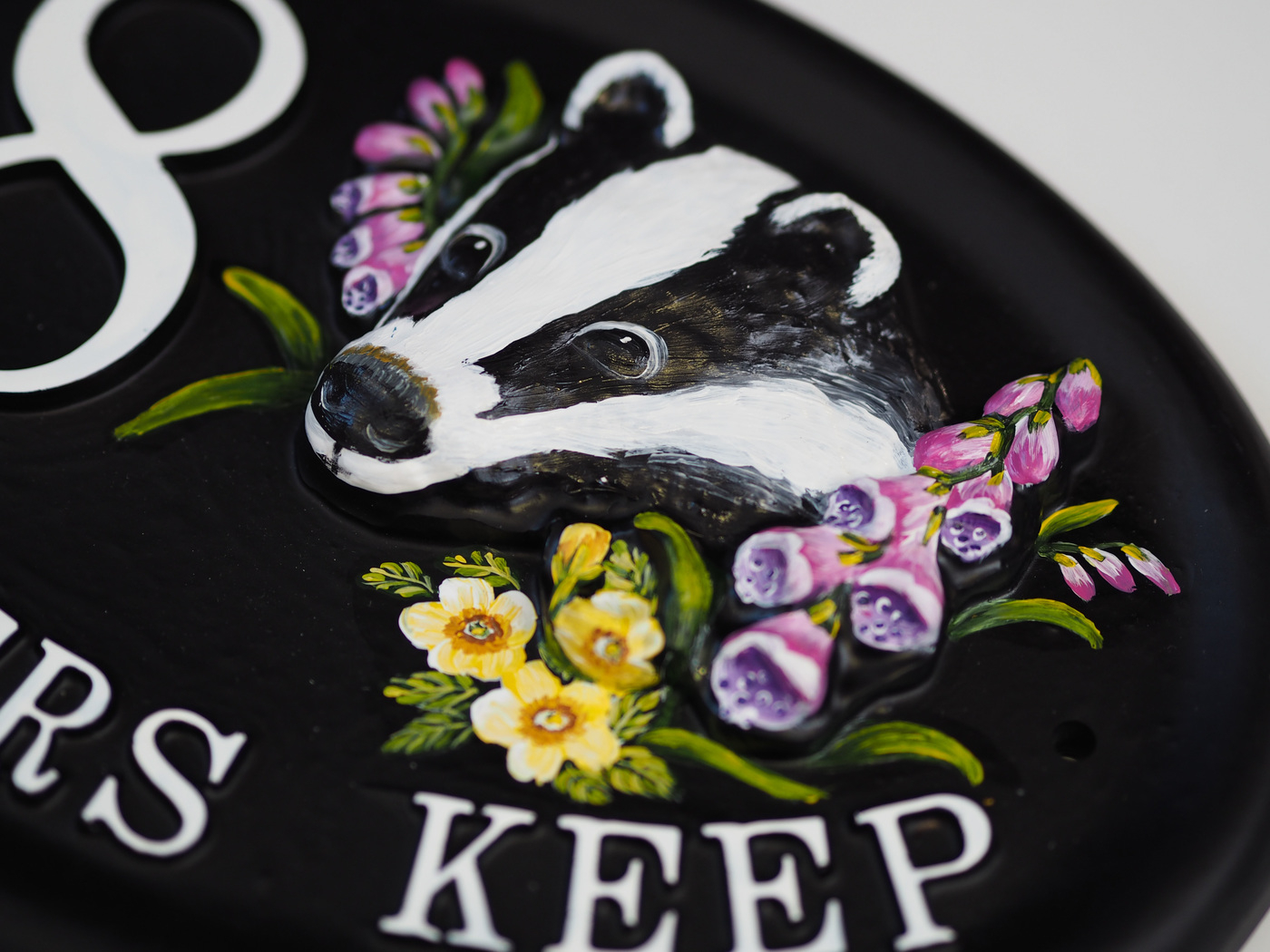 Badger Close Up house sign