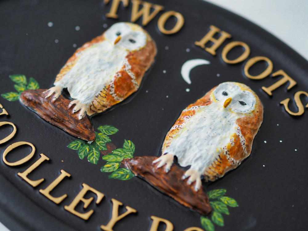 Owls Barn close-up. house sign