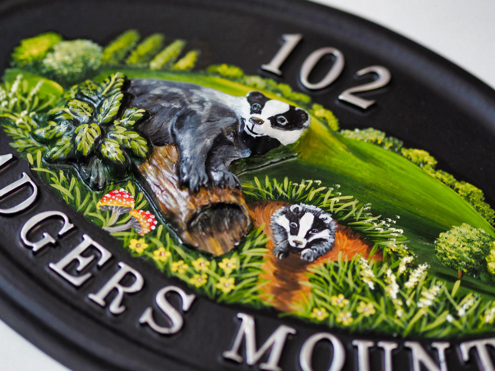 Badger & Flat Painted Badger close-up. house sign