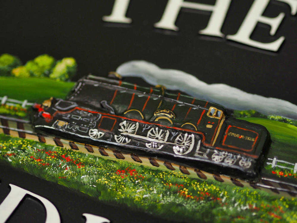 Steam Train close-up. house sign