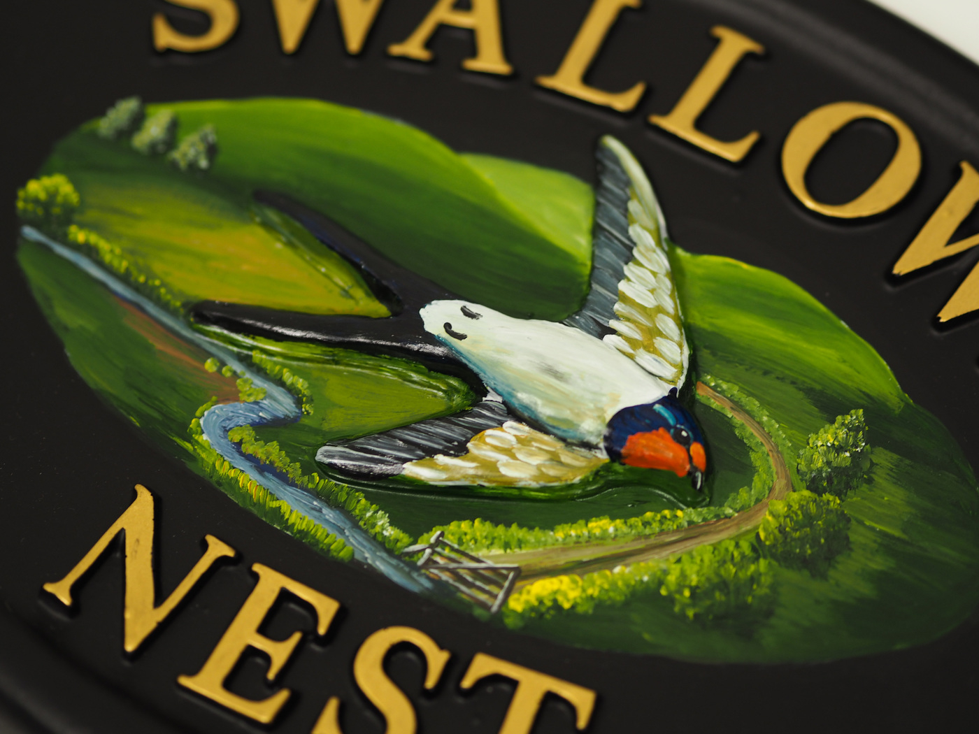 Swallows Close Up house sign
