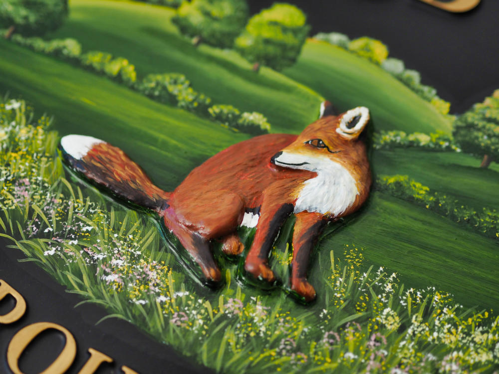Fox Sitting close-up. house sign