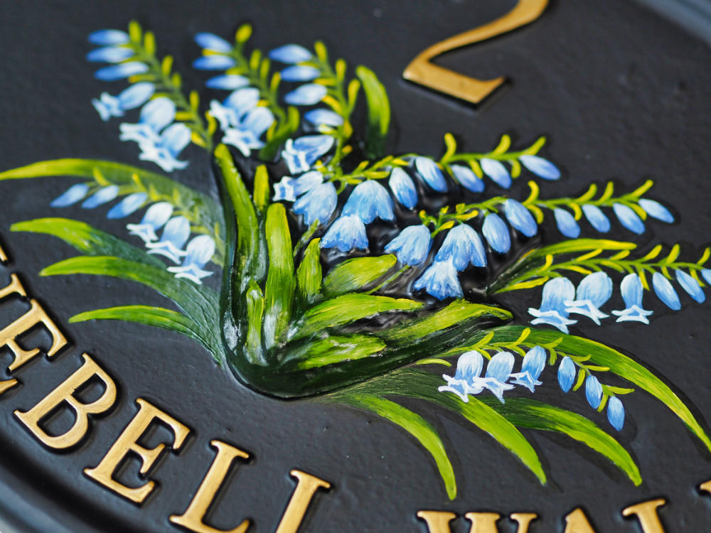Bluebells close-up. house sign