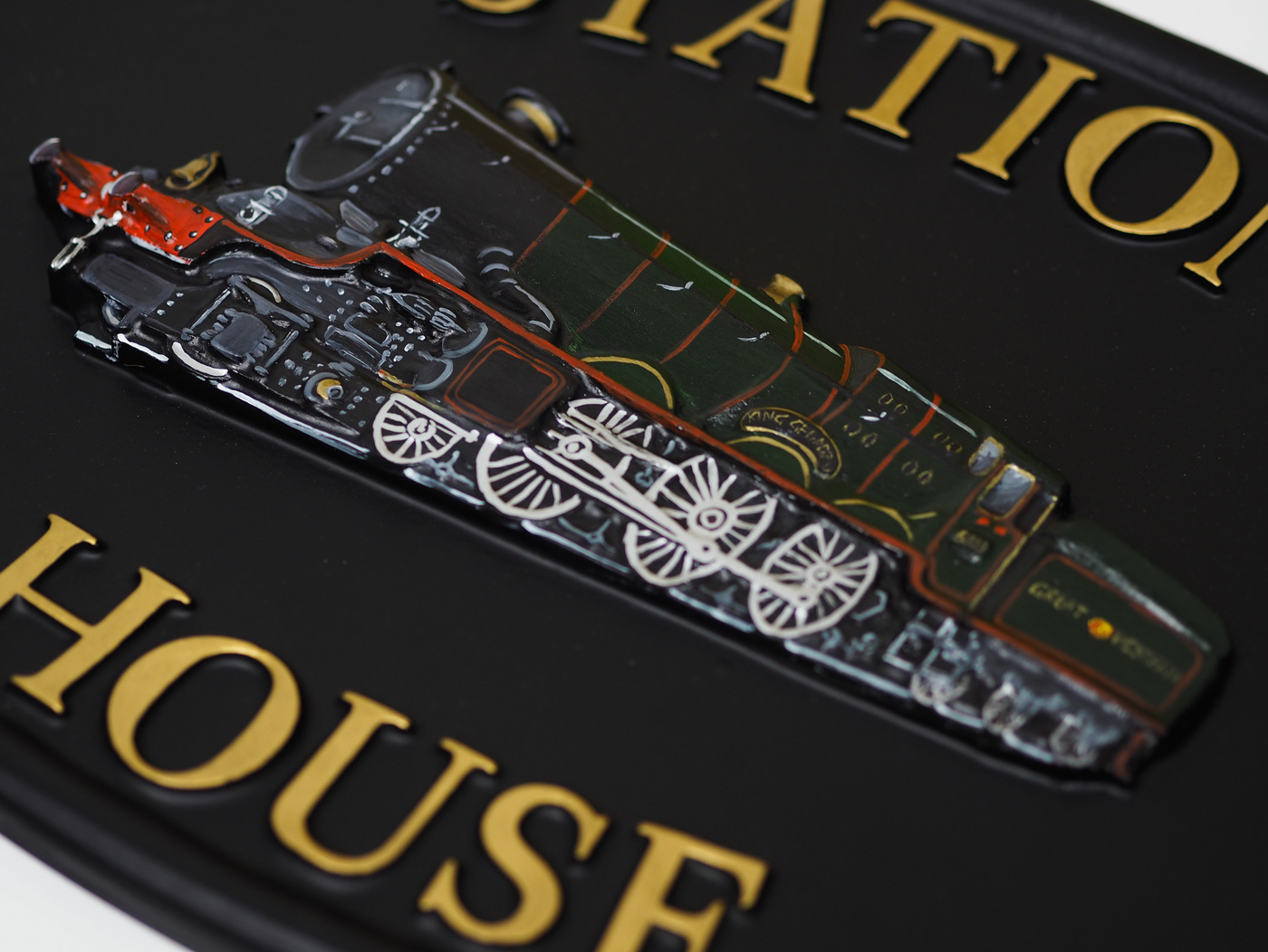 Train close-up. house sign
