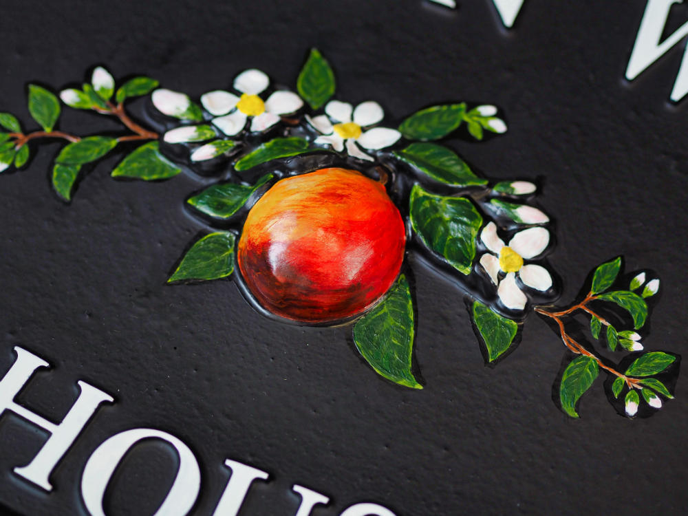 Apple And Blossom close-up. house sign