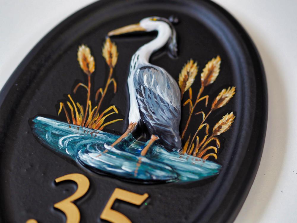 Heron Split Layout close-up. house sign