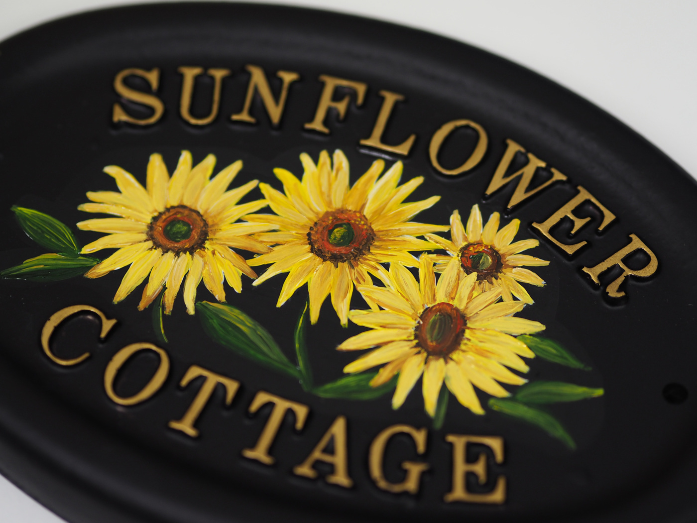 Sunflowers close-up. house sign