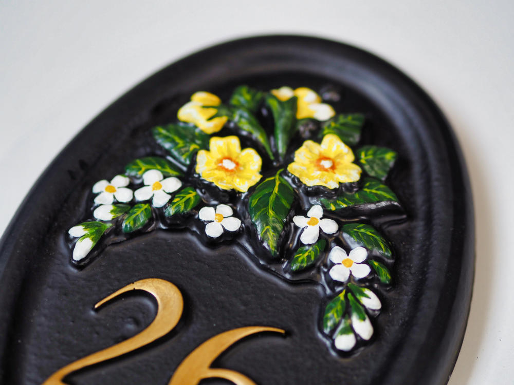 Primrose & Small Flowers close-up. house sign