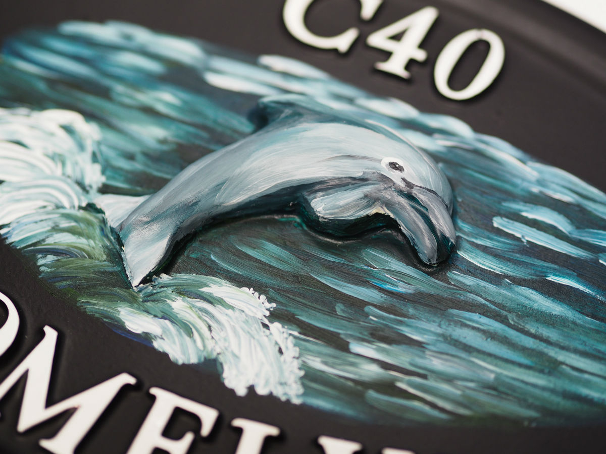Dolphin Close Up house sign