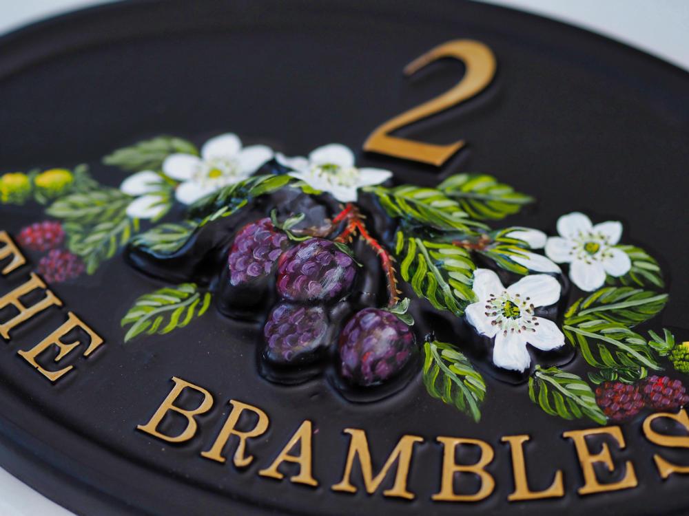 Brambles close-up. house sign
