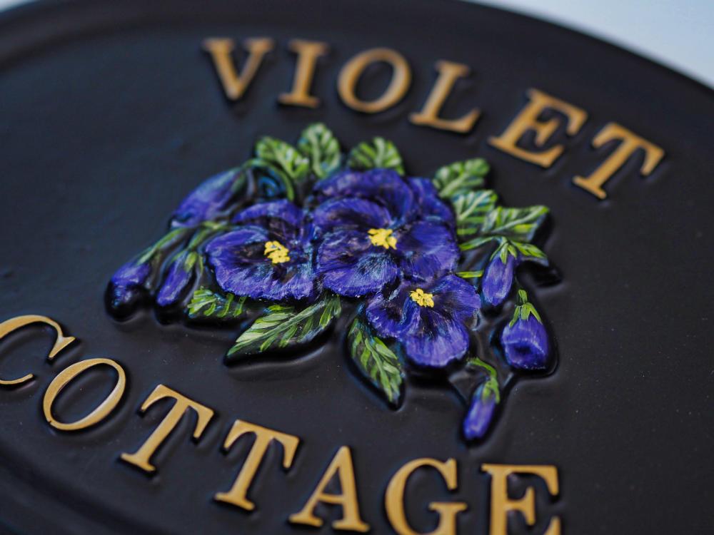Violets Split close-up. house sign
