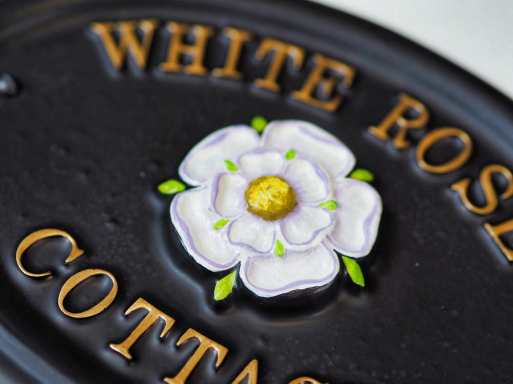 Yorkshire Rose close-up. house sign
